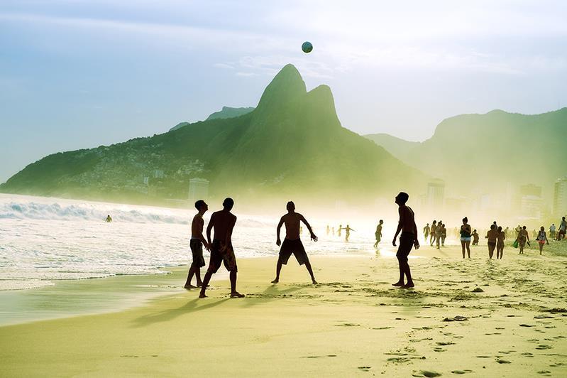 Brazilians playing football (Shutterstock)