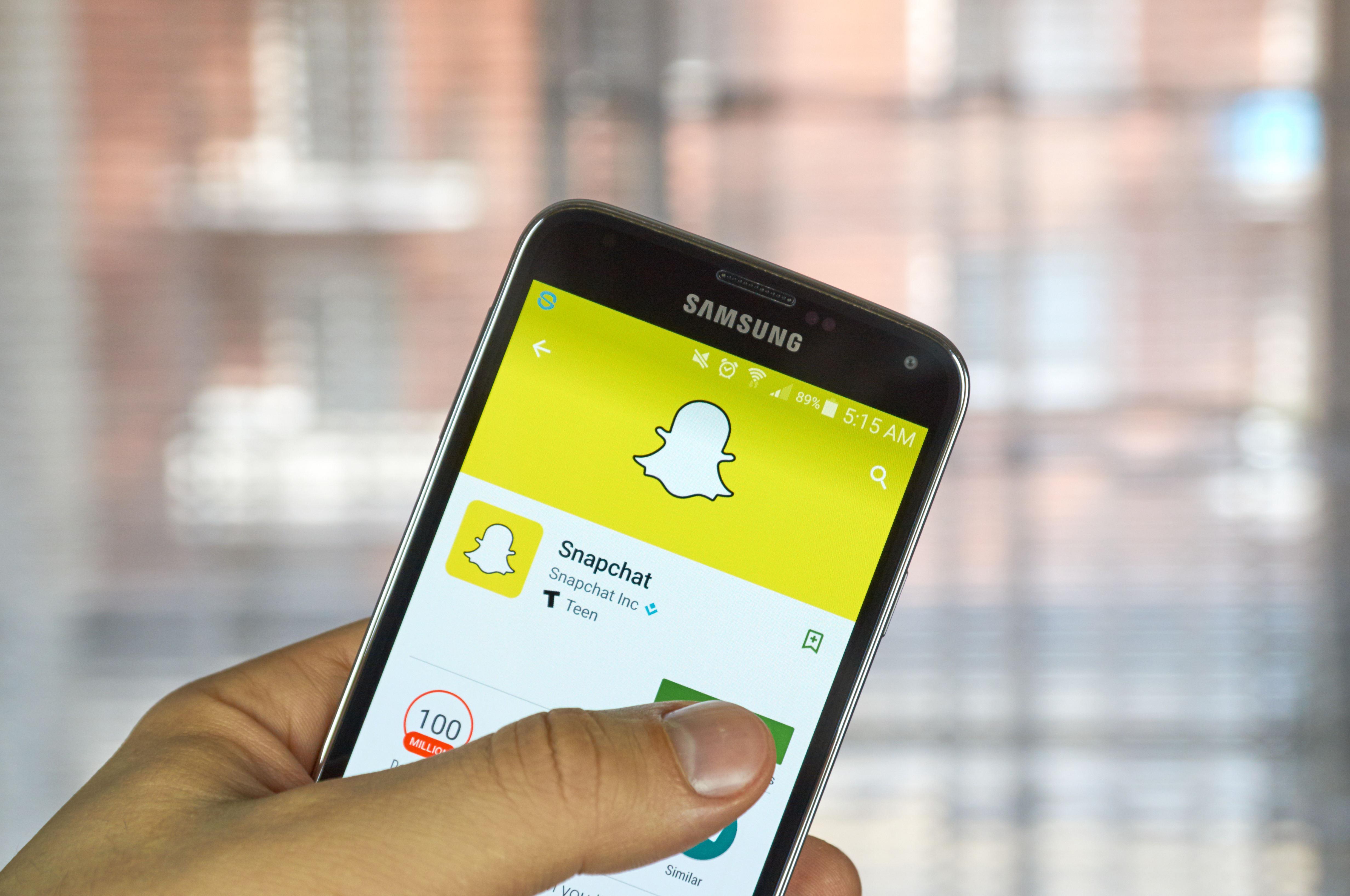 Snapchat on smartphone ()