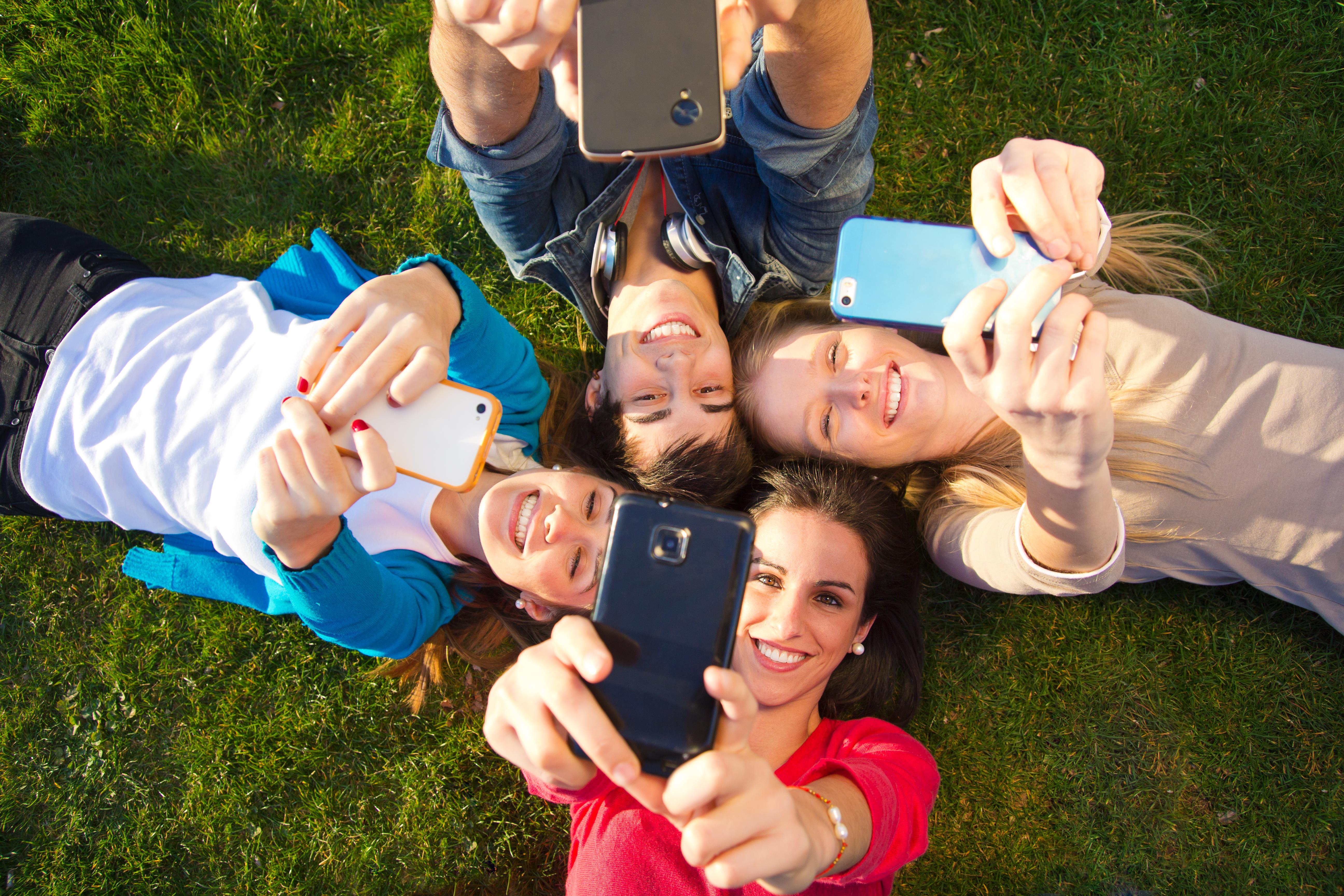 Teenagers on phones ()